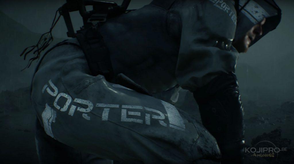 Sam porte une combinaison grise « Porter ».