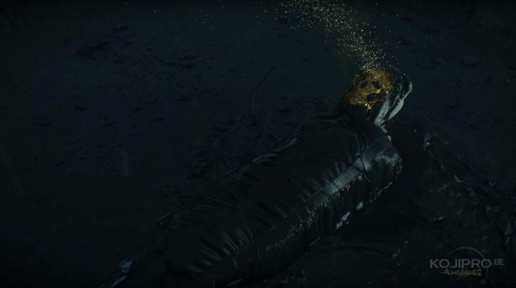 Le corps disparaît dans une flaque de liquide noir.